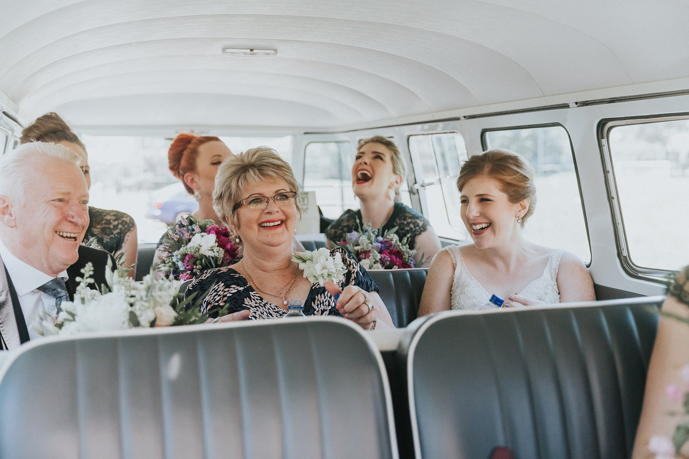 bridal party arriving at wedding ceremony in kombi