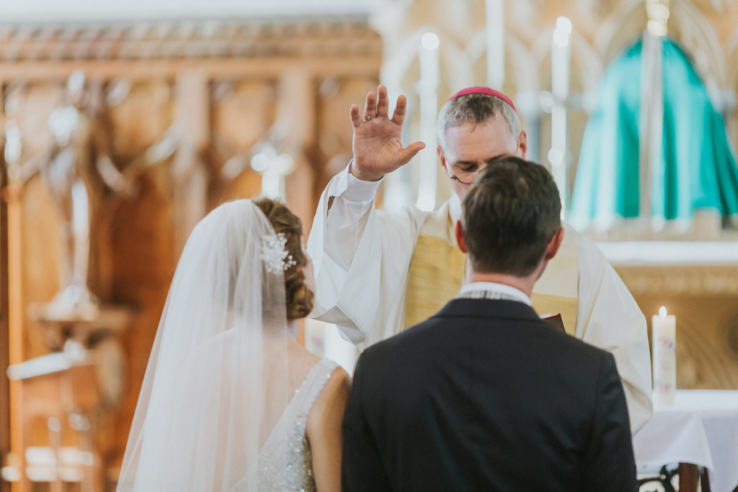 blessings for the bride and groom at catholic wedding