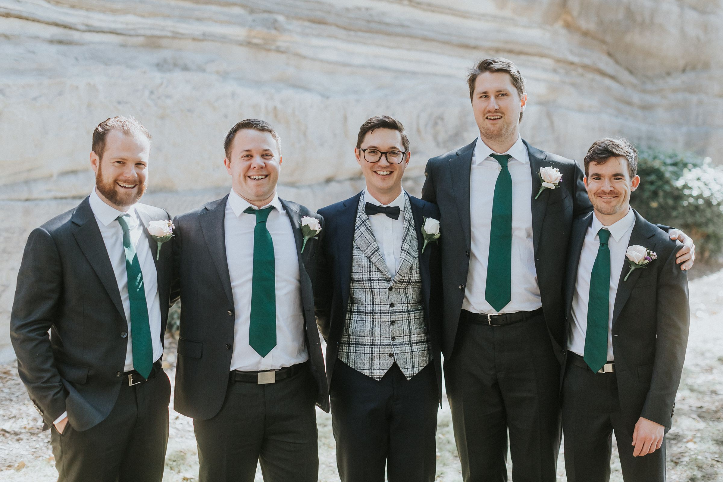 the rocks groomsmen portraits
