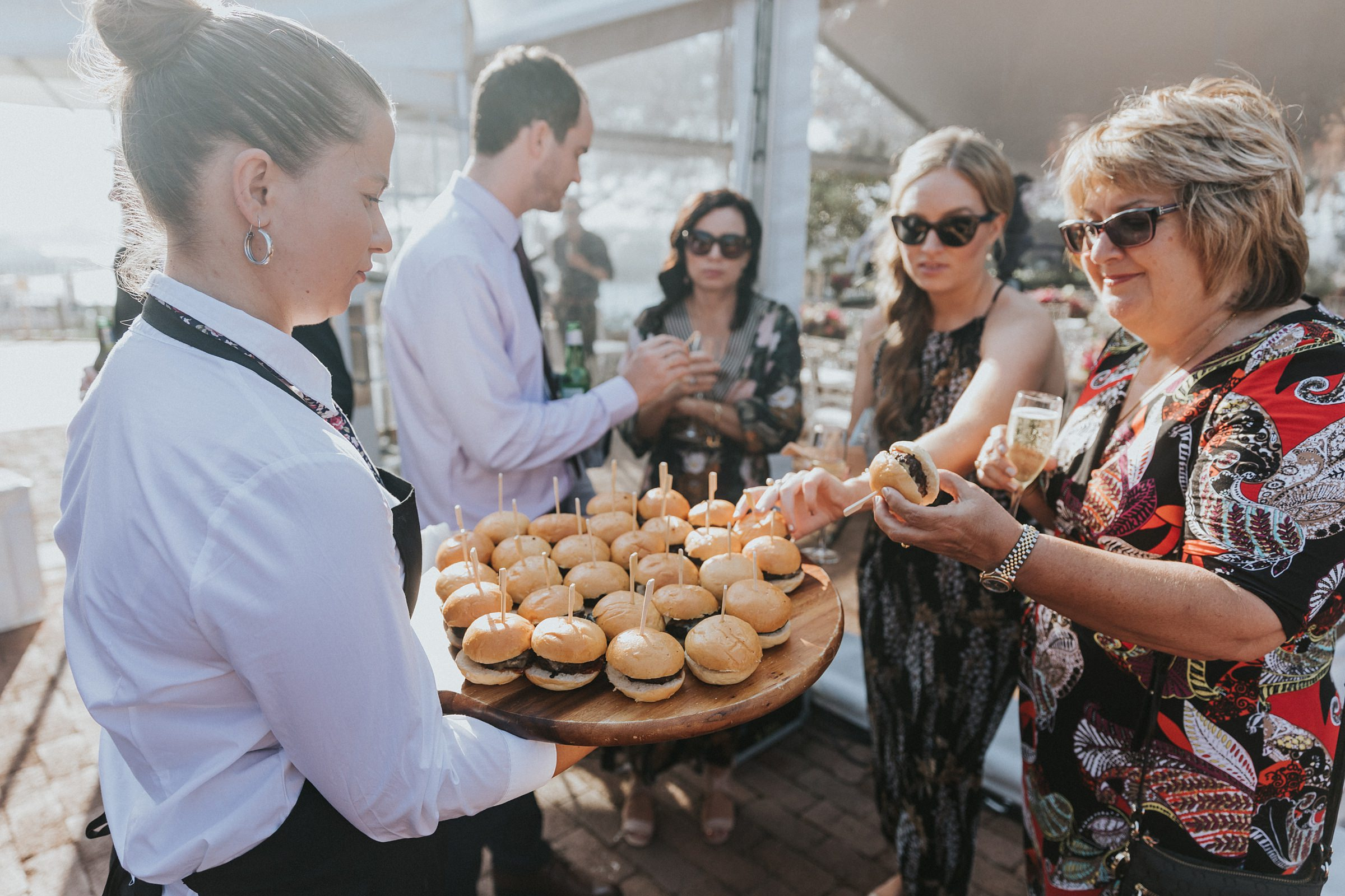 guests eating sliders at wedding reception at the sydney observatory