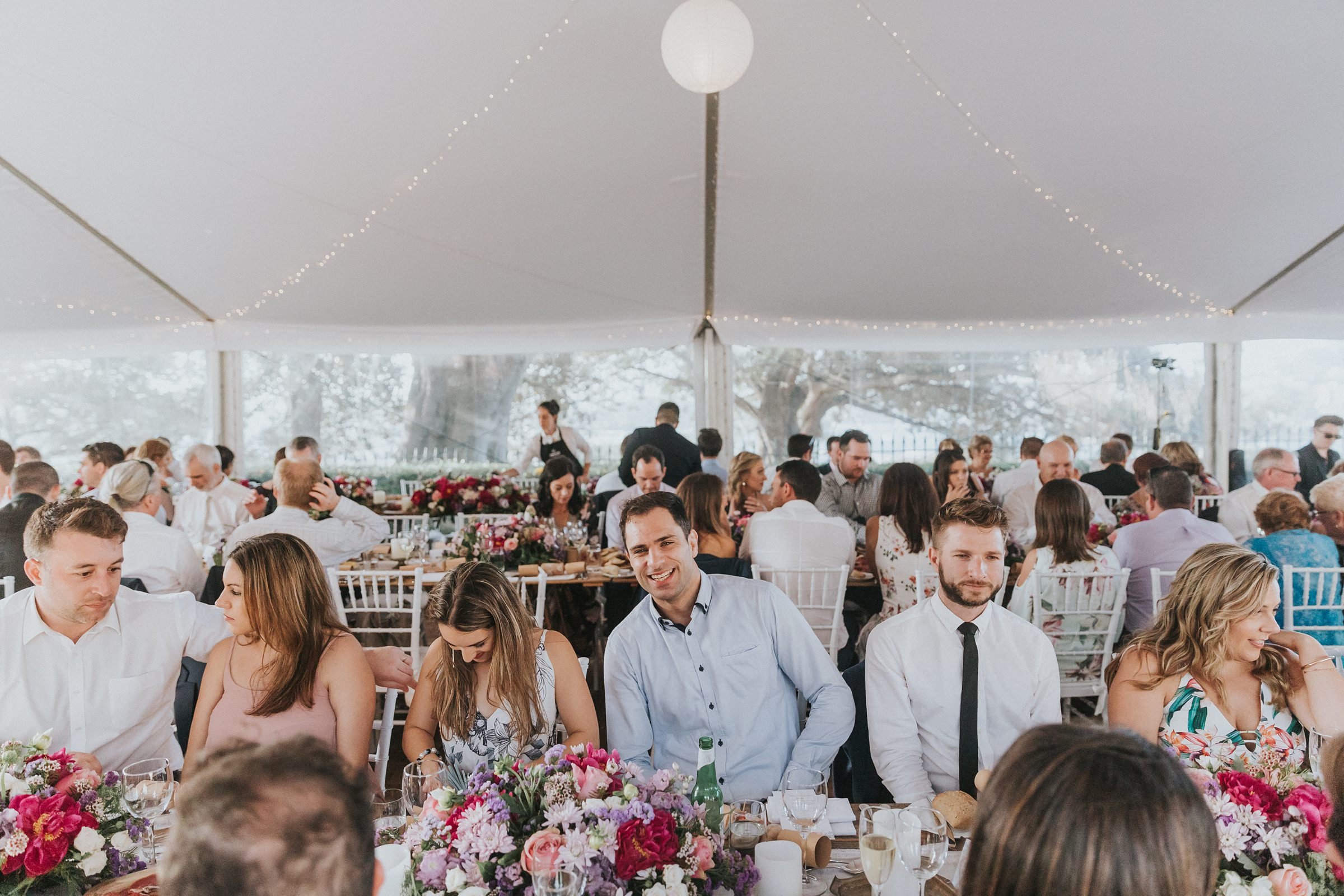 guests in the marquee for wedding reception