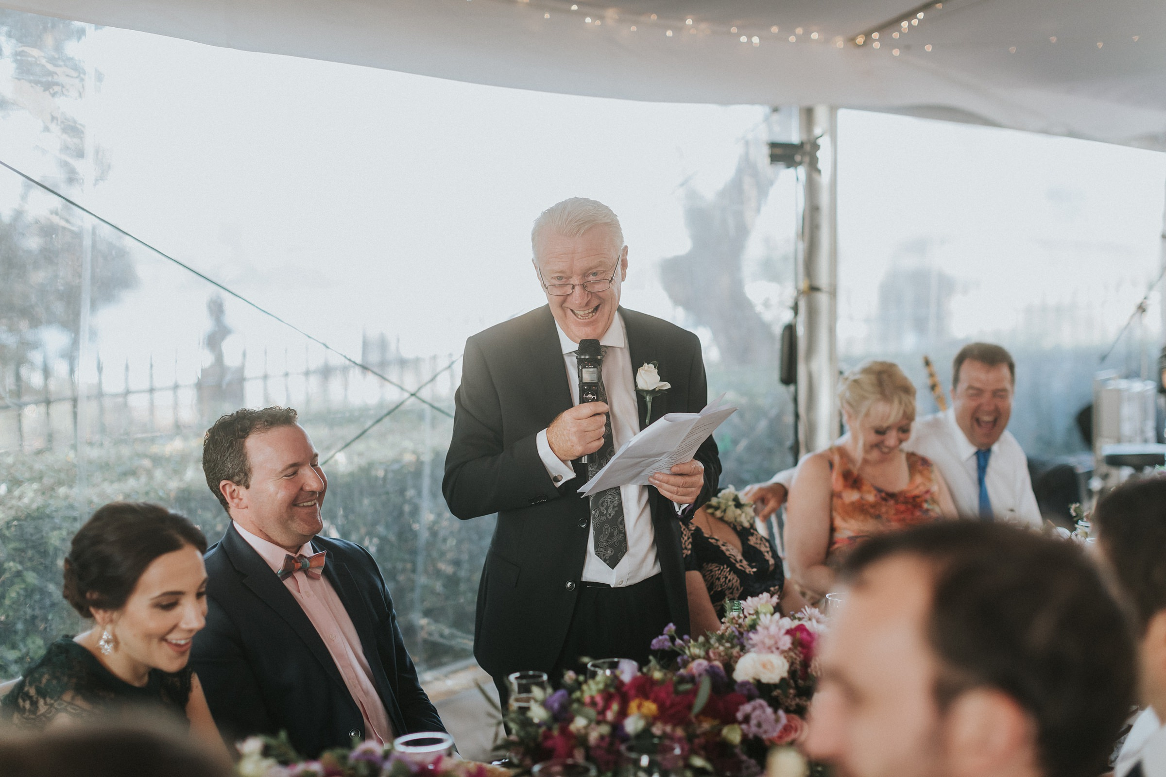 father of the bride speaks at wedding reception in sydney